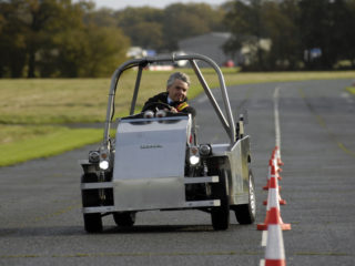 Lord Drayson, in an electric car