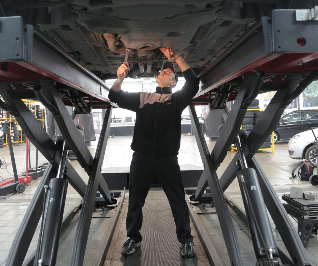 Man inspecting vehicle